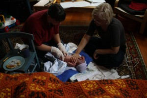 Midwives checking out a newborn