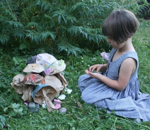 little girl building a fairy house
