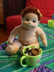 doll having a cup of acorn tea