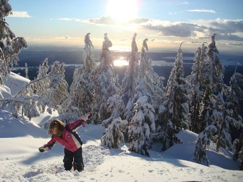 little girl snowshoeing