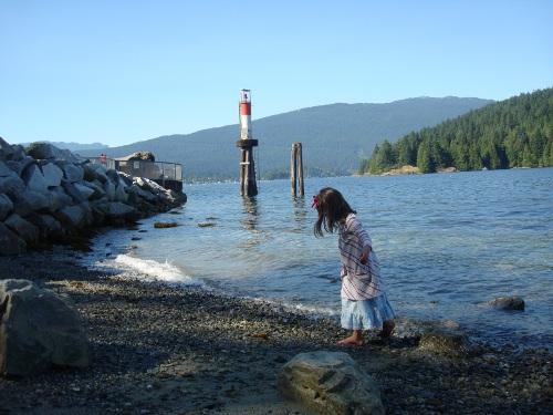 girl walking near a lighthouse