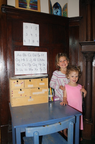 girls with their writing station