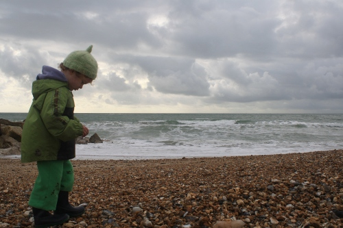 toddler on a windy winter beach