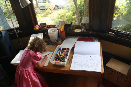 little girl colouring in a princess dress