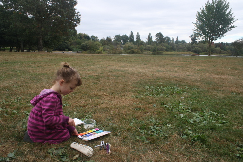 preschooler painting with watercolours at the park