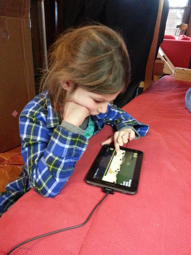 girl playing angry birds
