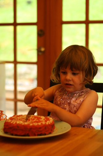 claire cutting her birthday cake